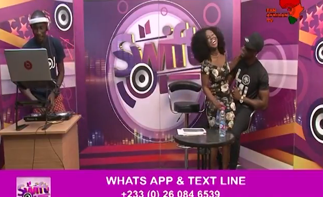 WATCH: E.L 'drags' TV hostess onto his laps during live show