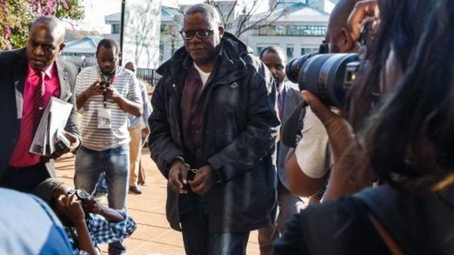 Handcuffed Zimbabwe politician in court